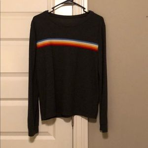 grey sweater with colorful stripes